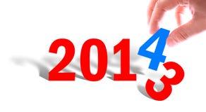 Les mains avec le nombre montre l'année 2014 Images libres de droits