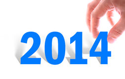 Les mains avec le nombre montre l'année 2014 Image stock