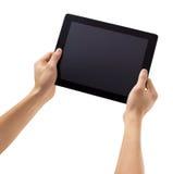 Les mains d'hommes tiennent un instrument d'ordinateur de pavé tactile de comprimé sur le fond blanc Photos libres de droits