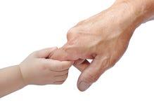 Les mains de l'adulte et de la chéri Photographie stock libre de droits
