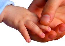 Les mains de la mère et de la chéri Images stock