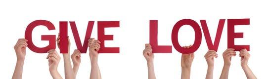 Les mains de personnes tenant Word droit rouge donnent l'amour Images stock