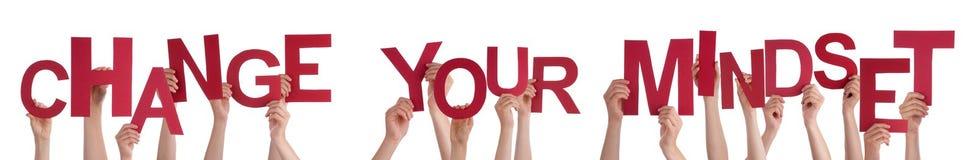 Les mains de personnes tenant Word rouge changent votre mentalité image libre de droits