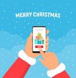 Les mains du père noël tient le téléphone avec des boîtes de cadeaux sur l'écran Weihnachtspakete - cadeau de Noël Concept d'envo illustration stock
