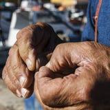 Les mains du pêcheur Photos libres de droits
