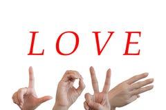 Les mains essayant d'envoyer des symboles aiment l'alphabet l'amour de mot Image stock