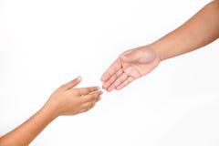 Les mains fait partie de la femme et de l'enfant de corps d'isolement pour l'aide Images stock