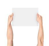 Les mains masculines vident le conseil vide blanc Photos libres de droits