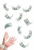 Les mains ont attaché des dollars Images stock