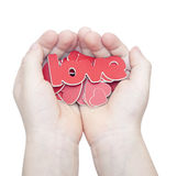 Les mains tiennent un amour de mot Image stock