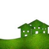 les maisons vertes d'eco ont isolé le blanc Images libres de droits