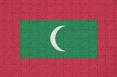 Les Maldives diminuent est dépeintes sur un puzzle plié photographie stock