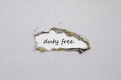 Les marchandises hors taxe de mot apparaissant derrière le papier déchiré Photos libres de droits
