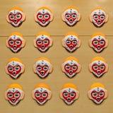 Les masques au visage de singe chinois de peinture Photo stock