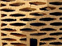 Les matériaux jaunes d'immeuble de brique Photographie stock