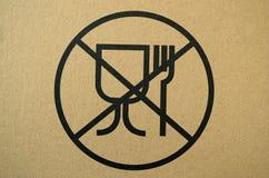 Les matériaux peu sûrs pour la nourriture entrent en contact avec le panneau d'avertissement Photographie stock libre de droits