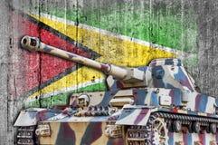 Les militaires échouent avec le drapeau concret de la Guyane Photographie stock libre de droits
