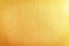 Les modèles de mur en béton d'or donnent au fond une consistance rugueuse abstrait photographie stock libre de droits
