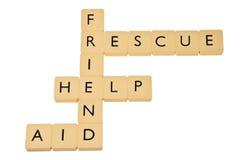 Les mots aident, sauvent, ami et aide. Image libre de droits