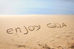 Les mots apprécient Goa écrit dans le sable Photos libres de droits