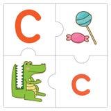 Les mots de match de puzzle denteux - C Photographie stock