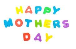 Les mots du jour de mères heureux ont formé par puzzle denteux d'alphabet Images stock