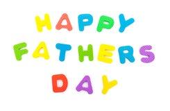 Les mots du jour de pères heureux ont formé par puzzle denteux d'alphabet Photographie stock libre de droits