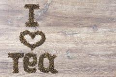 Les mots I aiment le thé fait de feuilles de thé vertes Images stock