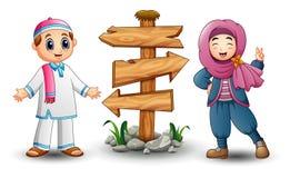 Les musulmans badinent les couples et le signe en bois vide de flèche illustration libre de droits