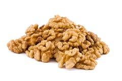 Les noix se ferment vers le haut d'isolement sur le blanc Photo stock