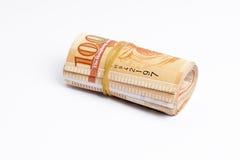 Les notes du dollar de HK roulent et marée avec une bande élastique Photo libre de droits