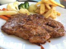 Les nourritures populaires superbes est porc de bifteck délicieux Images stock