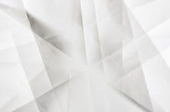 Les nuances du gris sur le blanc ont plié le papier Photographie stock libre de droits