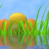 Les oeufs de pâques indique la prairie et le champ verts Image libre de droits