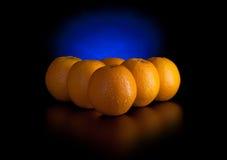 Les oranges aiment des billes de billard photographie stock libre de droits