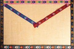 Les ornements sur le tissu représentent une carte postale unique Photographie stock libre de droits