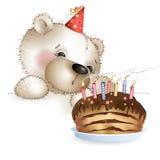 Les ours souffle des bougies sur le gâteau Image stock