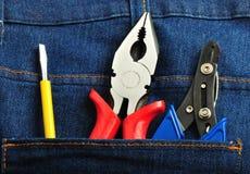 Les outils dans des jeans soutiennent la poche 2 images stock