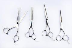 Les outils du coiffeur d'isolement sur le fond Photographie stock