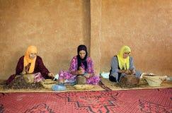 Les ouvriers d'argan Photos stock