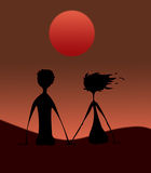 Les paires silhouettent sur le coucher du soleil illustration libre de droits