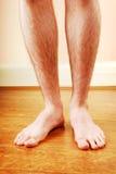 Les pattes d'un homme Photographie stock libre de droits