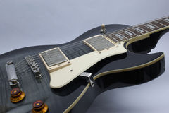 Les Paul style black guitar Royalty Free Stock Image