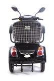 Les personnes âgées motorisées par noir de scooter de mobilité Franco Camion Photos libres de droits