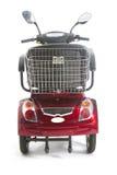 Les personnes âgées motorisées par rouge de scooter de mobilité Franco Camion Photos libres de droits
