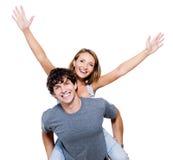 Les personnes heureuses avec les mains se sont soulevées vers le haut Photographie stock libre de droits