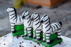 Les petites statues de zèbre pour prient le dieu Photos libres de droits