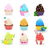 Les petits gâteaux dirigent l'ensemble d'isolement sur le fond blanc Pâtisseries douces Photos stock