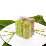 Les petits pains colorés de gaufre ont emballé dans le sac transparent dessus Image stock