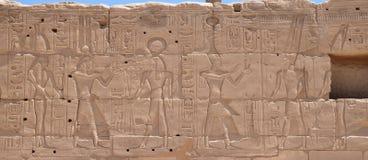 Les photos sur les murs du temple de Louxor Images stock